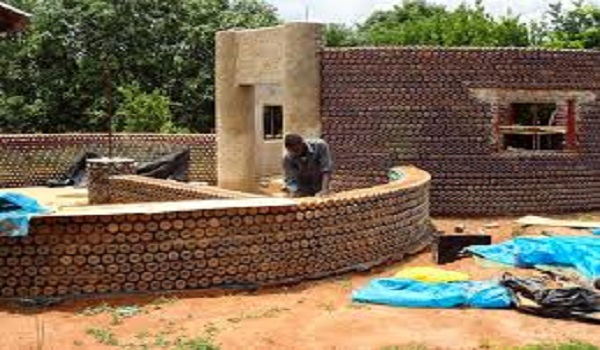 Nigeria ngos partner to build plastic bottles filled with mud houses for the homeless cpafrica - Building a house with plastic bottles ...